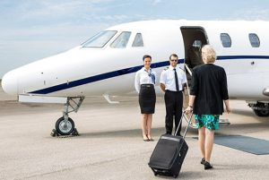 businesswoman boarding an airplane