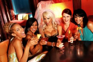 group of women enjoying drink at a bachelorette party